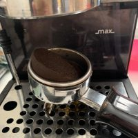 Just started using new beans and this keeps happening upon removing my  portafilter. Never had this happen before consistently. Pucks always come  out slanted diagonally shot after shot, any advice would be